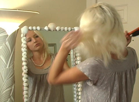 Beautiful Blonde Brushes Her Hair Stock Video Footage