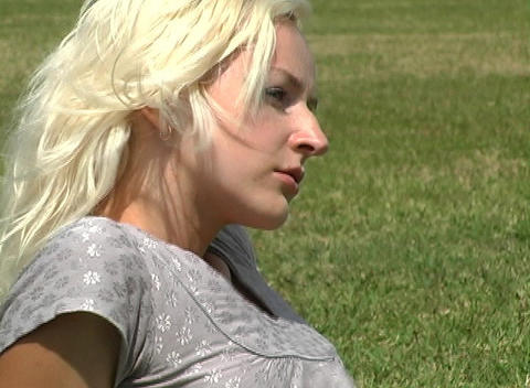 Close-up of a Beautiful Blonde Outdoors Footage