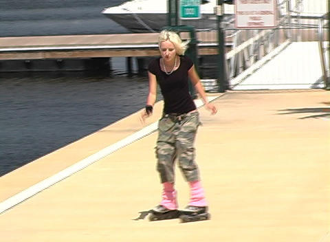 Beautiful Blonde Rollerblades Outdoors Stock Video Footage