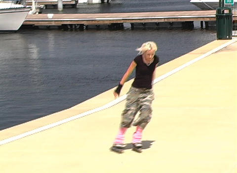 Beautiful Blonde Rollerblades Outdoors Footage