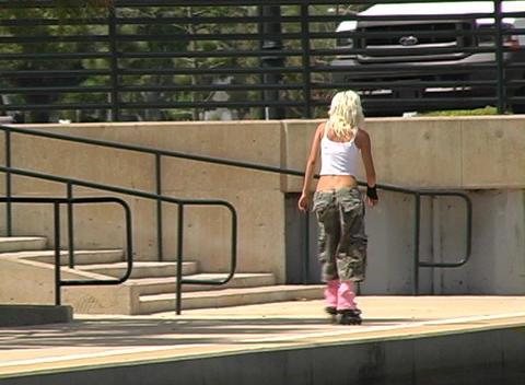 Beautiful Blonde Rollerblading Outdoors Footage