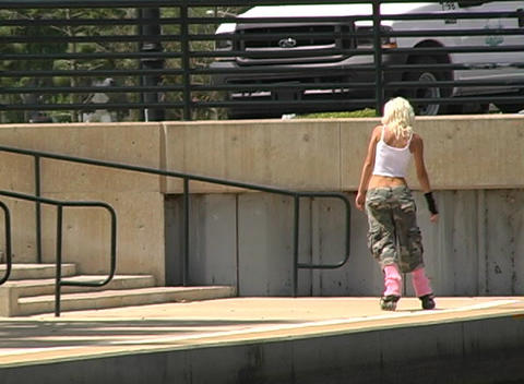 Beautiful Blonde Rollerblading Outdoors Stock Video Footage