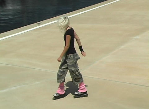 Beautiful Blonde Rollerblader Takes a Spill Stock Video Footage