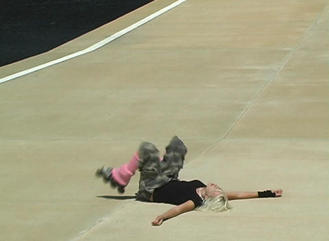Beautiful Blonde Rollerblader Takes a Spill Footage