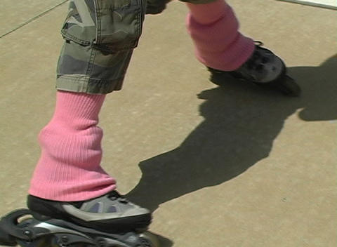 Beautiful Blonde with Rollerblades and Cell Phone Stock Video Footage