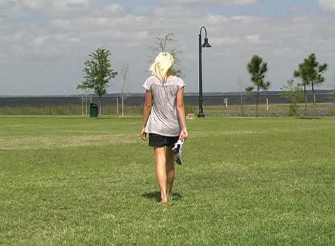 Beautiful Blonde Walking Outdoors Footage