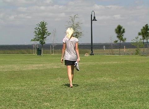 Beautiful Blonde Walking Outdoors Stock Video Footage