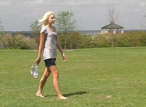 Beautiful Blonde Walking Outdoors Stock Video Footage