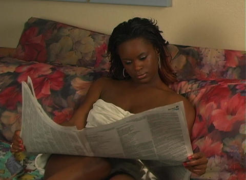 Beautiful Woman in Bed Reading a Newspaper-1a Footage