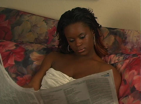 Beautiful Woman in Bed Reading a Newspaper-1a Stock Video Footage