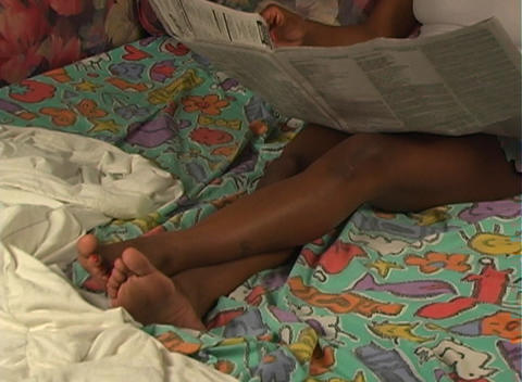 Beautiful Woman in Bed Reading a Newspaper-2 Stock Video Footage
