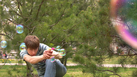 Playing with bubble gun Stock Video Footage