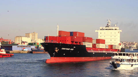 Cargo ship sailing out harbor Stock Video Footage
