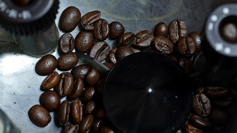 Coffee beans inside grinder Live Action