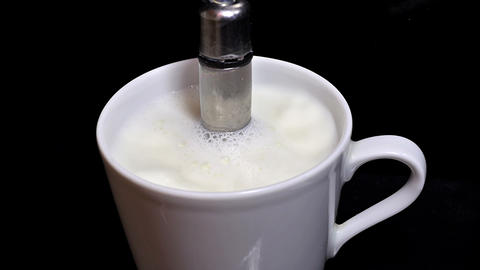 Heating milk - side view Stock Video Footage
