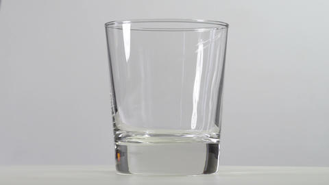 Pouring water into the glass Stock Video Footage