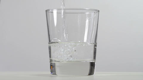 Pouring water into the glass Footage
