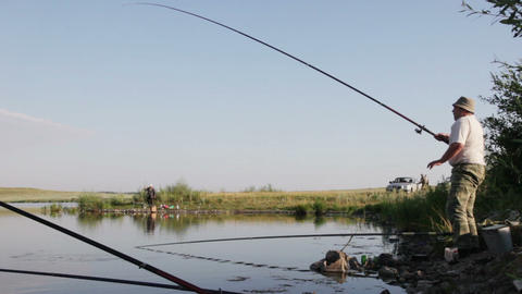 Fisherman caught a fish Stock Video Footage