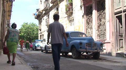 Havana Colonial buildings oldtimers streetview Stock Video Footage