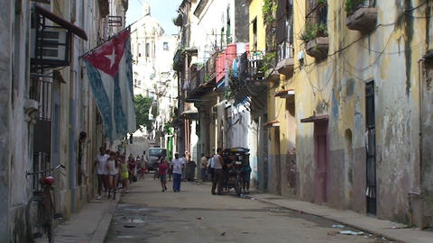 Cuban flag at Colonial buildings, streetview Stock Video Footage