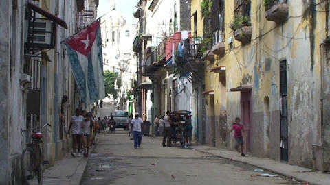 Cuban flag at Colonial buildings, streetview Footage
