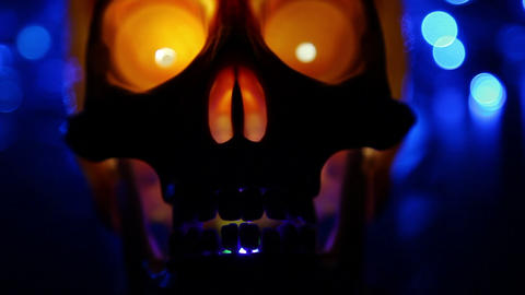 skull and defocused lights abstract background Stock Video Footage