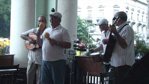 Salsa musicians on terrrace part 1 of 9 Footage