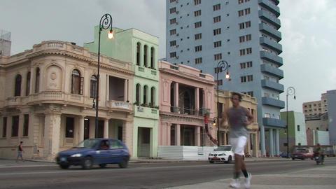Traffic on Malecón boulevard, running man Stock Video Footage