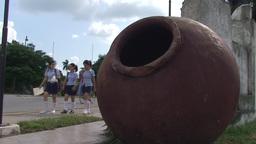 Big jar, schoolchildren passing by Stock Video Footage