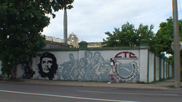 Cienfuegos Che Guevara on billboard woman passing Stock Video Footage