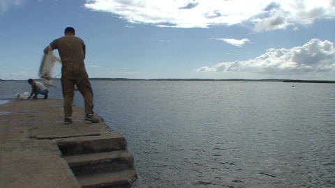 Cienfuegos Harber fisherman throws his net into wa Stock Video Footage