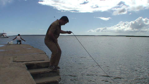 Cienfuegos Harber fisherman throws his net into wa Footage