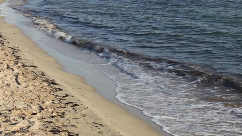 Surf lapping on a deserted tropical sandy beach an Stock Video Footage