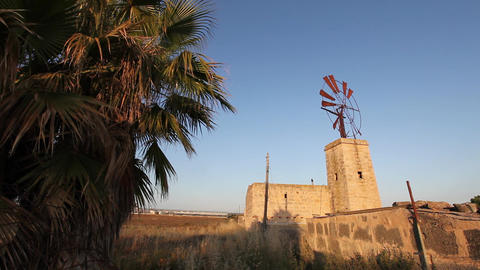 Windmill on top of a rural building Stock Video Footage