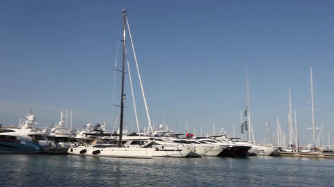 Row of motorised luxury pleasure boats and catamar Stock Video Footage