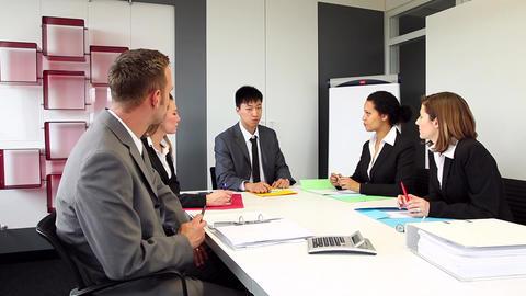Five international people having a business meetin Stock Video Footage