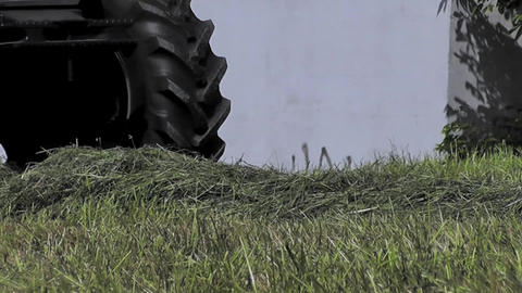 Close up view of a tractor harvesting hay Stock Video Footage