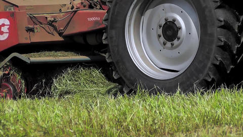 Close Up View Of A Tractor Harvesting Hay stock footage