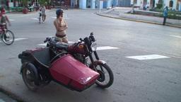 Cuba Sancti Spiritus Girl with tricycle on street Stock Video Footage