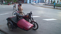 Cuba Sancti Spiritus Girl with tricycle on street Footage