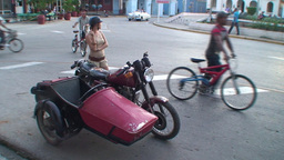 Cuba Sancti Spiritus Girl with tricycle on street Stock Video Footage