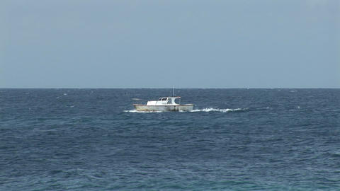 Small boat on ocean Stock Video Footage