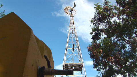 Windmill used to pump up water Stock Video Footage