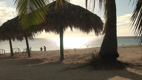 Trinidad Playa Ancón beachview palmtree and paras Stock Video Footage