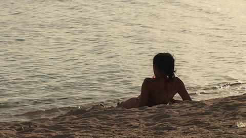 Trinidad Playa Ancón beachview sexy woman relaxin Stock Video Footage
