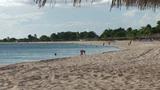 Trinidad Playa Ancón woman looking for shells Footage