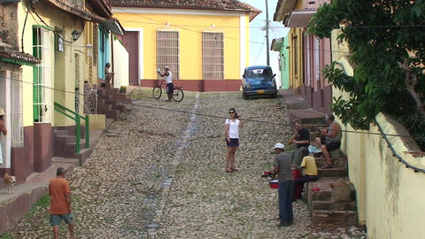 Trinidad Streetview Cuban people and tourist playi Stock Video Footage