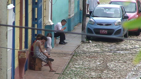 Trinidad Streetview Cuban people relaxing 2 Stock Video Footage