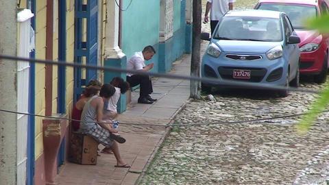 Trinidad Streetview Cuban people relaxing 2 Footage
