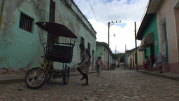 Trinidad Streetview Tricycle colonial buildings Stock Video Footage